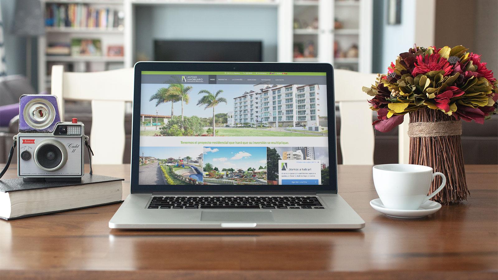antojo inmobiliario web laptop